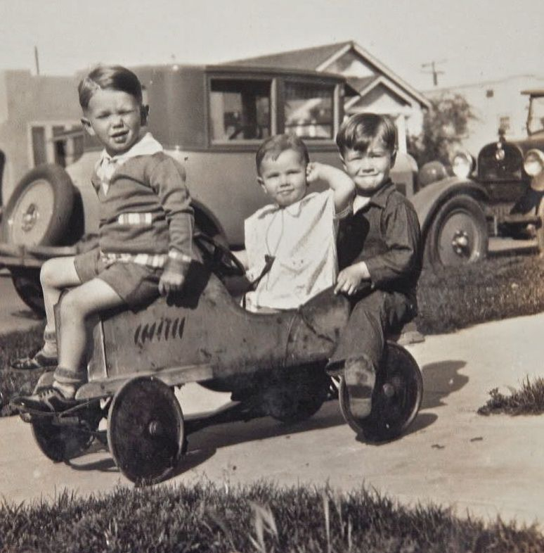this brings back memories probably to many of us of the fun we had in our pedal cars and coasters these cute kids in a mid to late twenties photo look to