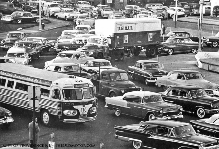 1960s Trafic Circle Street Scene filled with car and trucks