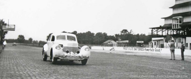 Ab Jenkins on a run witha Cord at the Indianapolis Motor Speedway in 1937