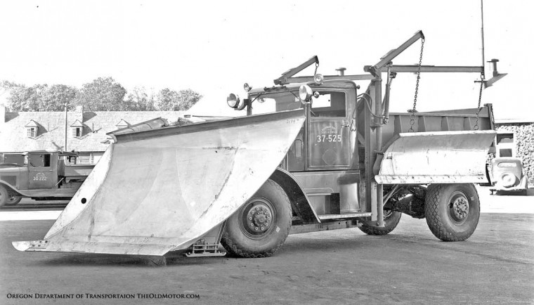 1937 Oshkosh four-wheel drive truck with V-plow and wing plows
