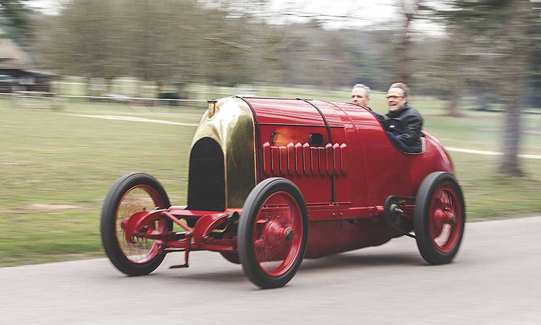 The 1911 S76 Fiat Belches Smoke And Fire As It Is Driven Up the Hill At Goodwood