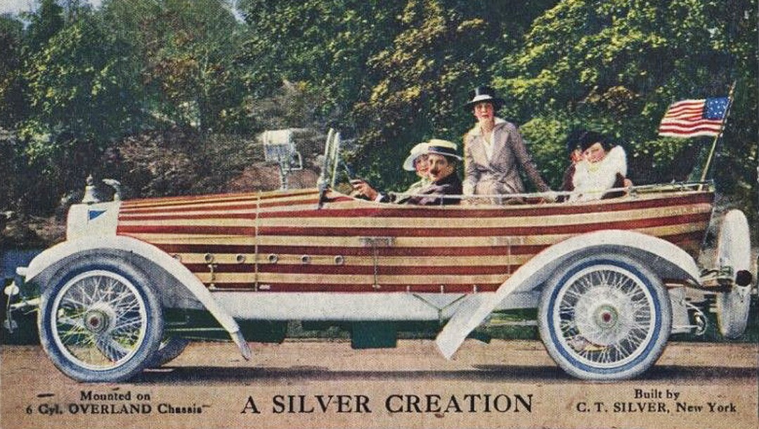 Silver Creation the C.T. Silver boat tail skiff Overland touring car