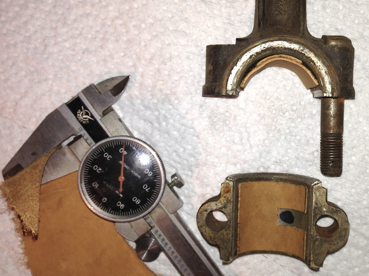 fashioning a piece of leather into a model T ford connecting rod bearing