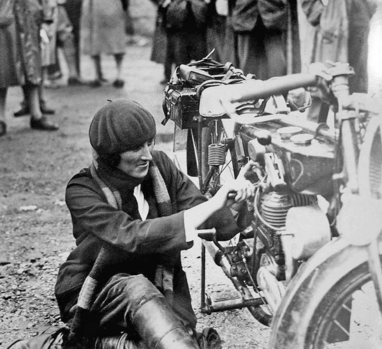 Woman Working on Motorcycle