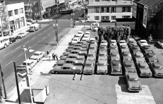 downtown-portland-oregon-parking-lot-1950s-cars-bus-station-chevron-gas-station-2