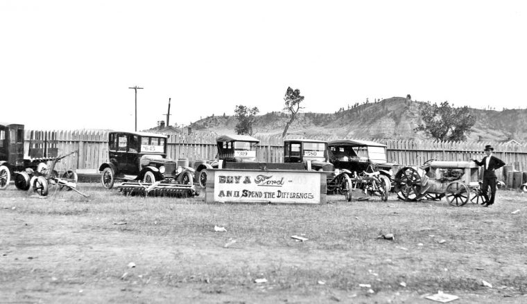 model-t-fords-and-ford-tractors-at-a-country-fair-1920s