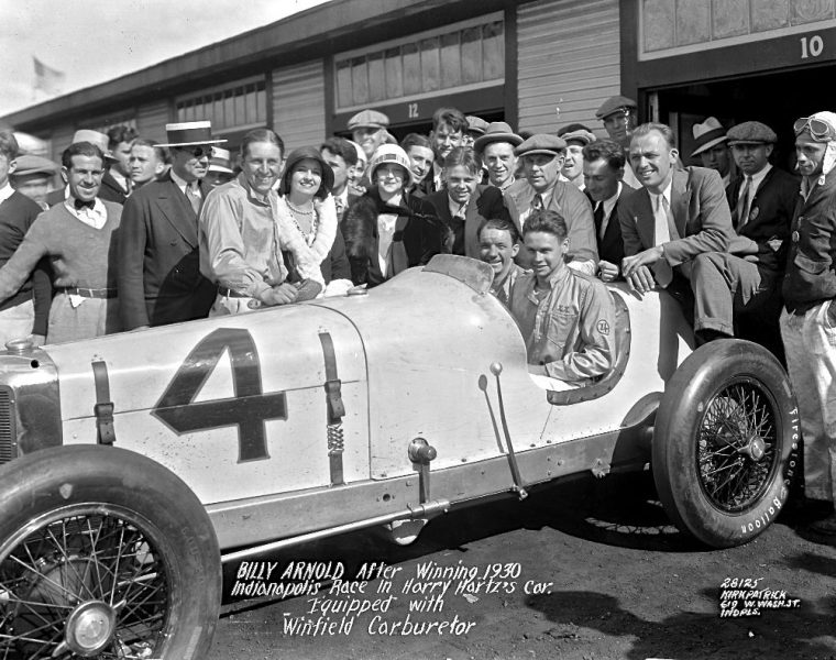In this May 30, 1930 photo provided by Indianapolis Motor Speedway, Billy Arnold, sitting at right, and his riding mechanic Spider Matlock pose after winning the Indianapolis 500 auto race at Indianapolis Speedway in Indianapolis, Ind. (IMS via AP) ORG XMIT: NY167