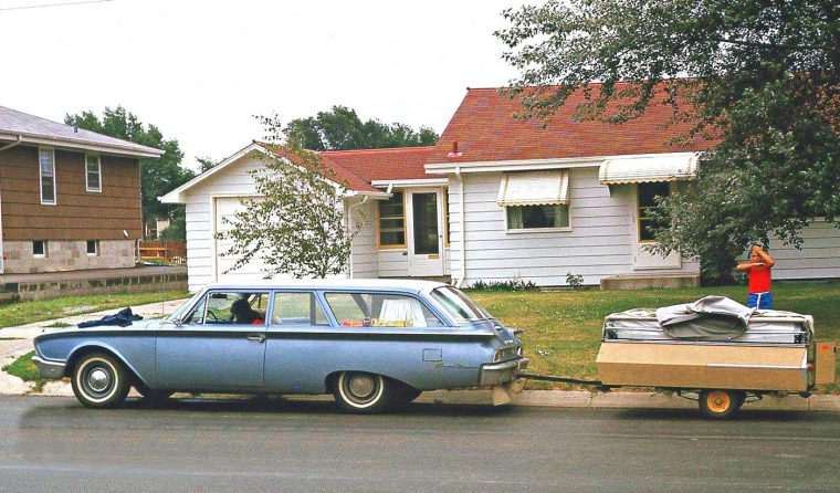 early-1960s ford two door station wagon and fold out camp trailer