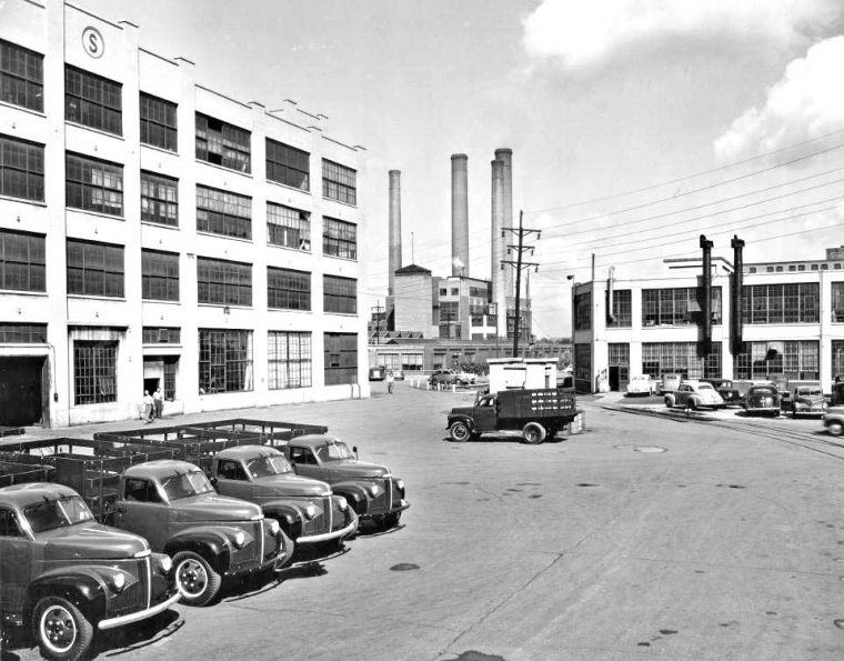 pre war studebaker factory with cars and trucks