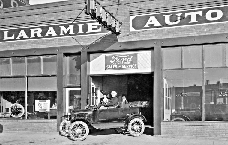 women taking delivery of a new ford speedster and touring car at laramie auto company the old. Black Bedroom Furniture Sets. Home Design Ideas